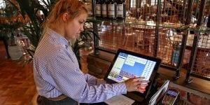 Waitress at cash register