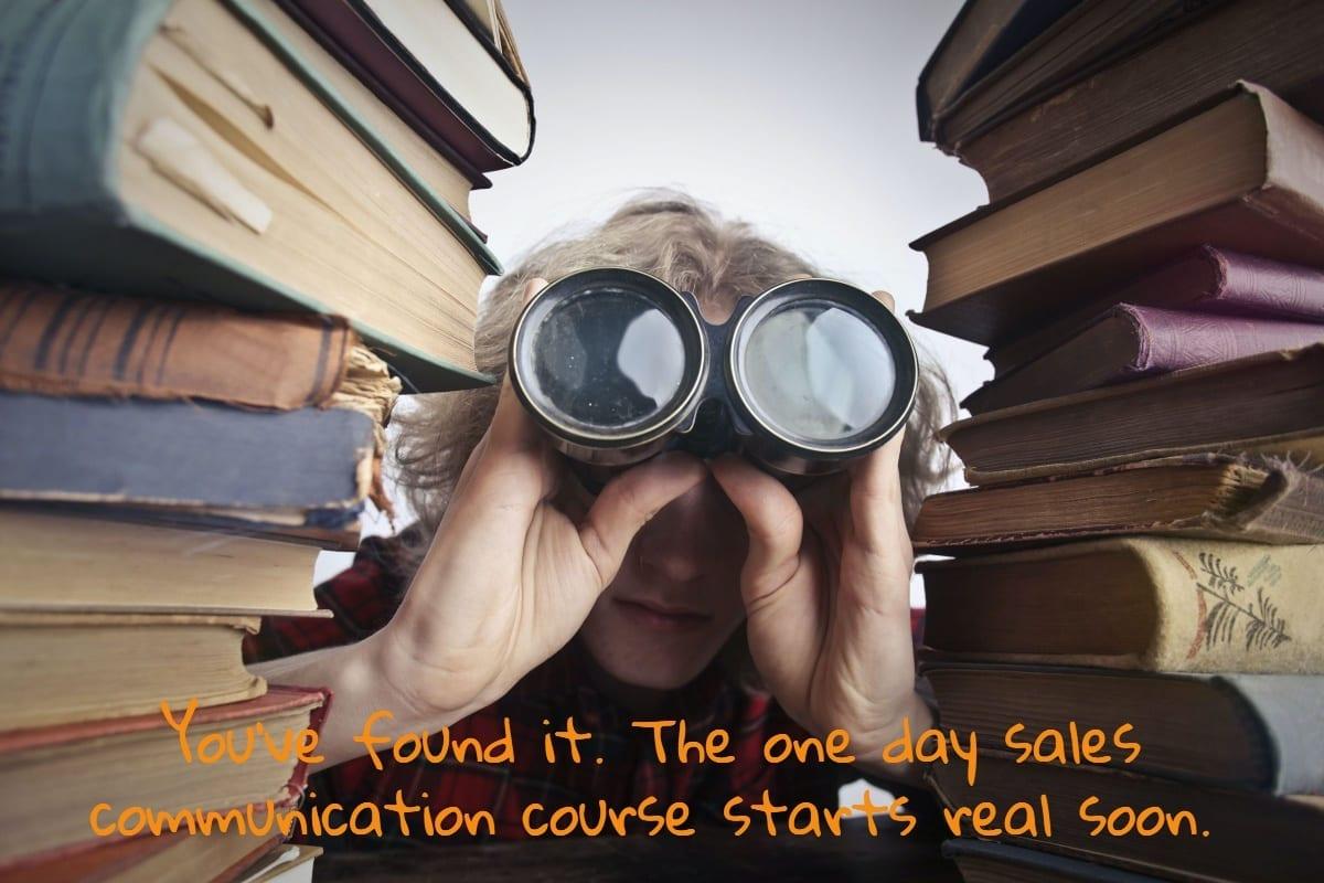 Librarian using binoculars