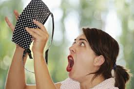 Woman shocked at empty purse